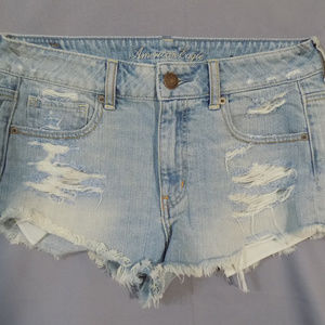 light wash distressed jeans shorts